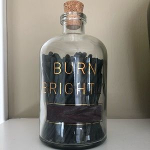 Jar with black matches